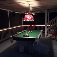 Upstairs screened in porch with pool table